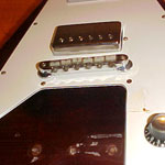 Flying V mahogany chevalet tune-o-matic retainer